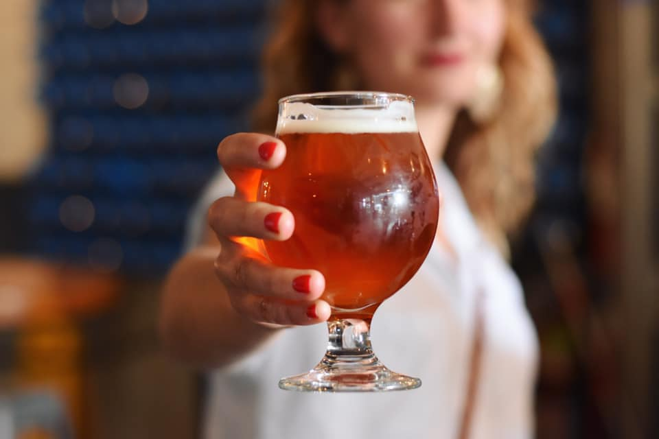 Woman holding IPA